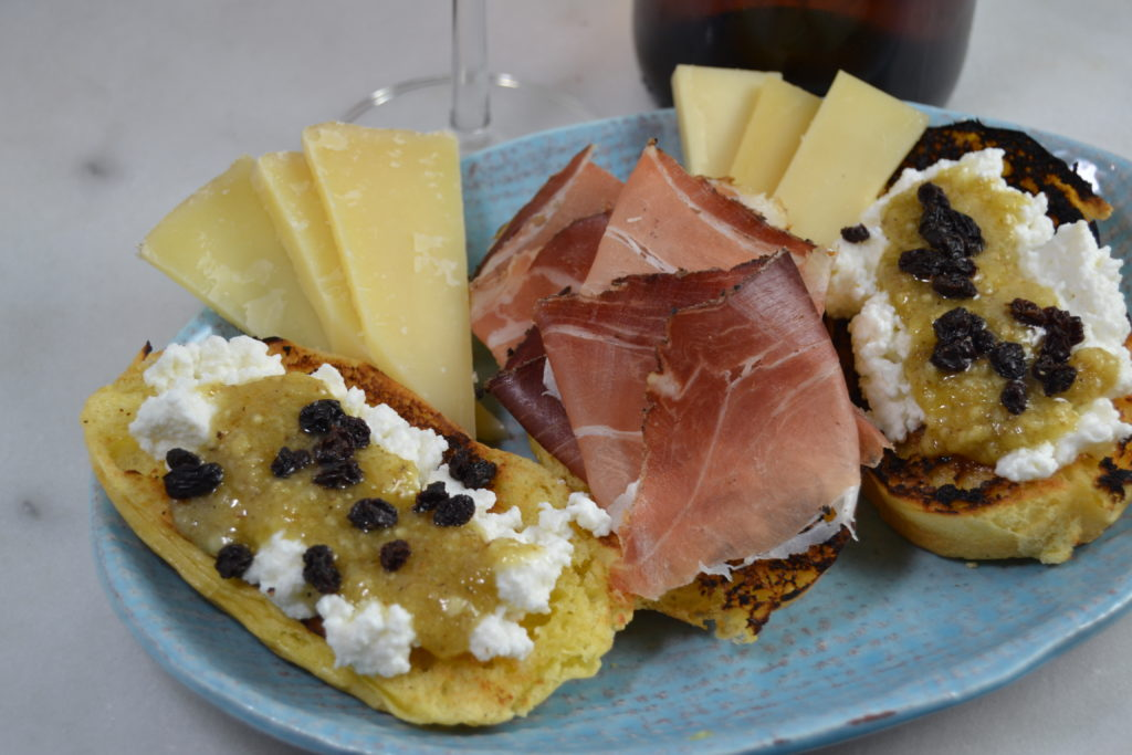 Walnut Pesto, Fresh Ricotta, Brioche, Speck and Northern Italian Cheeses pair well with Orange Wines